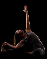 Revolved head-to-knee yoga pose (Charles Wills) Tags: yoga blackbackground processed yogaposes revolvedheadtoknee