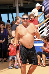Performing  for Votes (oxfordblues84) Tags: bear cruise shirtless man sunglasses ship fat contest stomach overweight fatman rccl shirtlessman radianceoftheseas overweightman royalcaribbeaninternational worldssexiestman shipcontest