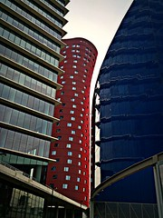 Funky towers of Barcelona (maistora) Tags: barcelona city blue original red color colour tree green tower nature glass up mobile architecture modern skyscraper buildings spain phone contemporary sony curves creative cellphone catalonia smartphone gaudi trunk bone catalunya form shape android futuristic app bold upward irregular influence adventurous unconventional maistora xperia flickrandroidapp:filter=none