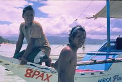 sailors (Simple Dolphin) Tags: ocean blue sea vacation portrait sky man film beach asian boat nikon fuji young sunny slide sail 135 boracay fm3a diapositive fm3 philippinnes