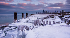 Chicago Winter (Out Of Chicago) Tags: city winter sunset chicago hancockbuilding ice beach skyline clouds canon pier frozen rocks searstower freezing lakemichigan explore pilings trumptower fullerton icebergs pinkclouds 6d chrissmith icecovered