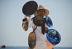 Plates (Neil Young Photography (nyphotos.ca)) Tags: travel vacation holiday man beach mexico cabo nikon pottery plates traveling peddler sales selling neilyoung cabosanlucas fotoman nyphotos d700 neilyoungphotography