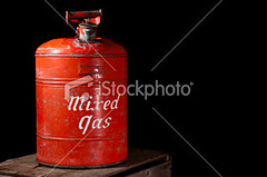 Antique Red Gas Can isolated on black. (Richard-7) Tags: old red inspiration black blackbackground dark mixed antique rusty can gas equipment nostalgia studioshot copyspace gasoline canister ideas isolated oldfashioned rundown gascan concepts gallon fossilfuel isolatedonblack retrorevival