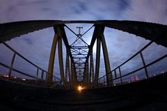 Caught in the Moonlight (Dan Constien) Tags: road city longexposure railroad bridge blue urban moon black night clouds canon river mississippi eos rebel lights long exposure glow shine angle wide rail wideangle iowa full fisheye mississippiriver erie t3 8mm dubuque canoneosrebelt3 8mmbower