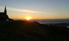 Friday Sunrise (lindawood2414) Tags: sunrise cloud light rays beam sea church road car beach slope