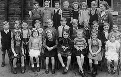 Cwmcarn Infants (theirhistory) Tags: children school class uk wales form photo group boys girls bachgen merch ysgol skirt shoes jumper sandals wellies bow shirt teacher wellingtons playground