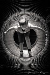 The cage (Giancarlo Filippini) Tags: mattia ritratto portrait monocromo gioco bambino gabbia tunnel