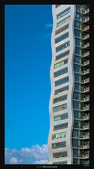 Vertical Waves (Ilan Shacham) Tags: architecture abstract tower building waves curves sky clouds tall adgar petahtikva israel fineart fineartphotography windows reflection