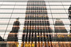 GMbldgRflctd (elizaroff) Tags: gm gmbuilding nyc ny newyork newyorkcity manhattan reflection reflections fragmented towers sherrynetherland sherry glass evening gold