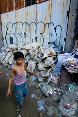 Yangon City (ross_123) Tags: city boy streets slr trash digital kid junk nikon asia yangon burma south capital dirty east rubbish myanmar d200 filth rangoon goldenland