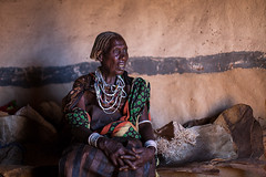 portrait of a woman Borana tribe dressed in traditional leather skirt inside the hut (anthony pappone photography) Tags: f12 gabbra nomad nomadi scarfhead scarf coverings borana yabelo girl omovalley necklaces wear cloth travel ritratto retrato reportage pose portraiture portrait picture phototravel photography photograher photo fotografia foto faces expression oromo digital culture colours colors colorful canon africa omo boranagirl boranatribe tribe face eyes etnologia etnico etnica etnic etnia etipia etiopija etiopien etiopia etiopi etiope ethiopie ethiopia afryka afrique afrika african      africantribe people woman beautiful hut capanna