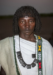 Afar Tribe Man, Assaita, Afar Regional State, Ethiopia (Eric Lafforgue) Tags: africa portrait people haircut men face vertical night hair photography necklace serious african culture tribal tradition ethiopia tribe ethnic hairstyle adultsonly oneperson amulet frontview confidence traditionalculture hornofafrica individuality ethnology afar eastafrica traditionalclothing realpeople colorimage lookingatcamera onlymen onemanonly teenagersonly traveldestination