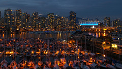 Vancouver (gibbler49) Tags: city mountain canada water skyline night vancouver boats lights downtown glow cityscape bc dusk monk olympus zuiko e510 1454mm mcqueens