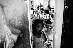 Life in The White Building - Classes (tamjty) Tags: poverty life street city school girls people urban blackandwhite bw students girl monochrome photography asia cambodia southeastasia apartments classroom candid voigtlander poor streetphotography photojournalism documentary class fujifilm phnompenh f4 journalism slums shantytown 21mm thewhitebuilding tamjty