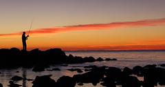 Fisherman (Edimur) Tags: blue sunset red sea sun rome roma beach evening fishing fisherman tramonto mare dusk blu sole rosso pesca spiaggia pescatore sera santasevera crepuscolo fishingrod cannadapesca