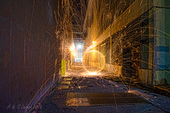 A Ball of Fun (SimplyAmy74) Tags: nightphotography washington alley spokane downtown nocturnal citylights washingtonstate steelwool balloffun