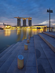 Mothership (night86mare) Tags: park city morning blue motion water lines marina sunrise reflections bay hall singapore deep line sands merlion k5 blend 10mm