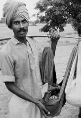 Father and baby (bokage) Tags: road baby india man father bangalore turban karnataka burden