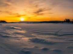 Sunset skitracks on the frozen fjord (spookst) Tags: sunset orange sun snow ice yellow oslo norway clouds frozen tracks fjord skitracks
