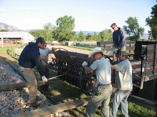 Photo - OSMP staff unloading a grain drill