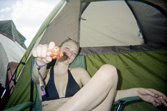 Bonnaroo - 2012 (JeffWellerPhotography) Tags: road trip summer color film water girl smile female 35mm toy gun cigarette diary leg tent plastic bikini blonde smirk sly knee bonnaroo disposable 2012 colornegative jeffweller