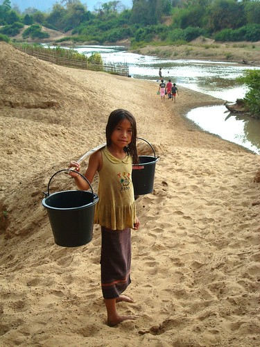 Girl fetching water from river in Lao, PDR. Photo by Yamiko Kura, 2011.