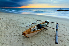 Traditional fisherman boat on a gloomy evening (Macbrian Mun) Tags: ocean wood old travel blue light sunset red sea vacation sky orange seascape storm color colour detail tourism beach nature water colors clouds rural season