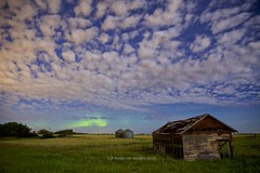 August Nights are just a little darker (John Andersen (JPAndersen images)) Tags: alberta aurora borderfx clouds farm fence granary jpandersenimages mosquito night shed