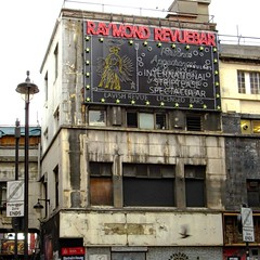 Spectacular No Longer (john atte kiln) Tags: raymondreveubar london soho seedy derelict dereliction rundown wornout defunct dirty drab oldfashion timepassed england britain uk unitedkingdom building boardedup lamppost international striptease lavish neonlights neondisplay