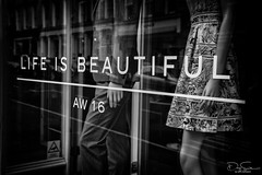 Life is Beautiful (Daz Smith) Tags: dazsmith canon6d bw blackwhite blackandwhite bath city streetphotography canon citylife thecity urban streets uk monochrome blancoynegro life beautiful shop window reflections words letters slogan clothes