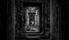 Ancient passage (Stan Smucker) Tags: monochrome blackandwhite passage passageway angkorwat ruins path travel temple cambodia landscape