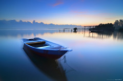 relaxation (azrudin) Tags: travel blue light sea vacation sky panorama lake reflection art beach nature water silhouette festival sunrise landscape island photography mirror boat still lowlight nikon slow jetty wave tokina1224 filter malaysia slowshutter nightshots bluehour scapes graduated kelantan waterflow longexposures tumpat nd8 graduatedfilter 6stop sifoocom gnd09 d7000 bw106 azrudin jubakarpantai