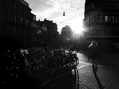 backlit girl (Lszl_F) Tags: shadow blackandwhite bw sun girl amsterdam silhouette backlight person blackwhite fuji bikes bicycles lensflare flare fujifilm sunflare x10 fujifilmx10