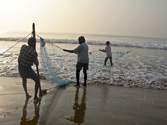 Fishermen at work (Tapas Biswas) Tags: life morning travel sunset sea people india color colour net nature water silhouette outdoors boat twilight fishing fisherman nikon day view image artistic candid unity vivid creation nets orissa boatman fishy fishingnets candidphotography seabeach realpeople d90 indianculture nikond90 onlyindian nikod90 nikond9o