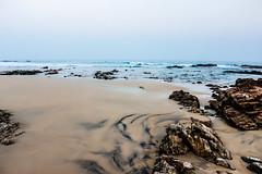 Over the rocks (akkaramkrishna) Tags: longexposure sunset blackandwhite india mountains canon rocks flickr beaches lr vizag hws 600d flickraward blinkagain