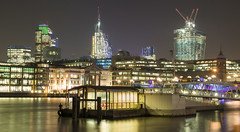 From South Bank (MartynHall ) Tags: street city bridge house building london tower heron ferry thames night skyscraper river lights boat town long exposure crossing crane south capital bank tourist southbank cranes beacons bishopsgate leadenhall fenchurch eyegarbage martynhall