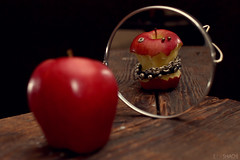 Hardcore Covetousness (Levi Shiach Photography) Tags: wood red reflection art apple rotting fruit 35mm canon table mirror necklace flash 14 earring style jewelry piercing hardcore 7d bolt bracelet faux subject concept nut rotten core false strobe pictureperfect conceptualphotography conceptphoto 580exll canon7d