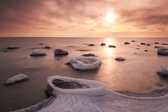 Baltic kiss II (fausbanderspree) Tags: winter sunset red snow ice germany rocks day stones balticsea rgen