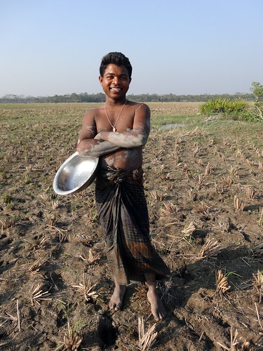 A proud farmer in Jhalokhati, Bangladesh. Photo by Mélody Braun, 2013.