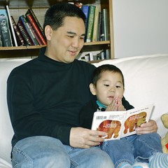 Reading a book for daddy. (LugerLA) Tags: lumix reading voigtlander gf2 brownbearbrownbearwhatdoyousee colorskopar35mmf25