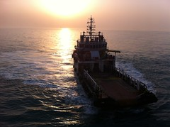 Tugs and Persian Gulf Sunset