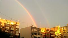 Doble arcoiris (E. Maria M) Tags: iris luz sol rain arcoiris lluvia rainbow ciudad nublado arco ocaso doblearcoiris