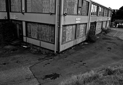Derelict 2 (Nathan Lisher) Tags: urban blackandwhite bw white black west building architecture buildings sussex blackwhite nikon secret cctv demolition structure architectural used cropped fencing dslr derelict structural redundant shoreham shorehambysea unused derelictbuildings architecturalphotography survaillance croppped shorehamairport nikondslr nikond3000 structuralphotography