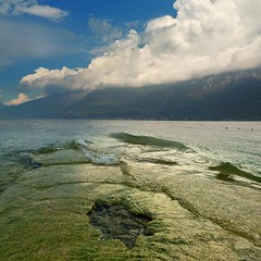 Lake Garda where air meets water (Bn) Tags: park blue summer vacation sky italy holiday mountains colour water weather sport rock del clouds swimming landscape fun lago coast carved topf50 garda mediterranean italia waves sailing wind unique air kitesurfing di windsurfing fjord relaxation shape majestic topf100 climate gem turbulence gardameer lakegarda discover campione benaco 100faves 50faves bresciano altogarda largestlake
