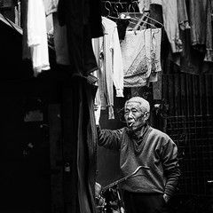 the lives of others~ Old smoker~ Shanghai alley (~mimo~) Tags: china old portrait blackandwhite man look bike square photography alley asia shanghai smoke laundry jewish smoker oldcity thelivesofothers honkou oldjewishghetto mimokhair findingyourselfinthestreets