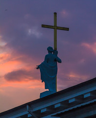 Welcoming the Dusk (Roblawol) Tags: baltics cathedral church clouds colorful colors cross dusk europe evening formersovietunion formerussr historical history inspiring lithuania purple sculpture sky statue summer sunset vilnius woman