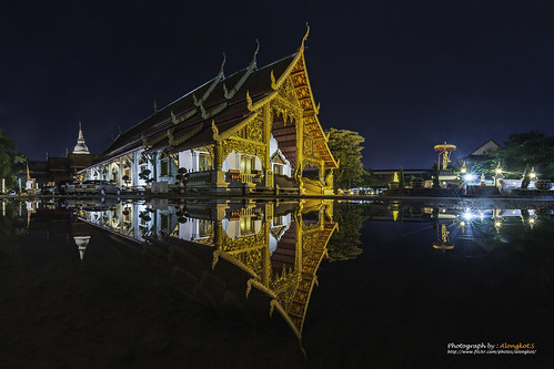 Wat Phra Singh temple at twilight. This temple contains supreme examples of Lanna art in the old city center of Chiang Mai,Thailand.