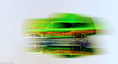 Hot Wheels (peterphotographic) Tags: img6690ed1cb2lolokitedwm canon g15 camerabag2 peterhall walthamstow e17 eastlondon london england uk britain macro macromondays closeup inthemirror movement motion toy toycar green blur flash hotwheels reflection mirror chrysler plymouthbarracuda hemi