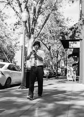 Proper Texting (Tim Roper) Tags: wan beret sidewalk street texting walking