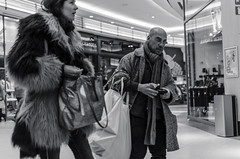 Furrier Shopping (enzymeB) Tags: brussels mall shopping fur nikon belgium coat streetphotography shoppingcentre blackandwhitw nikkor35mm